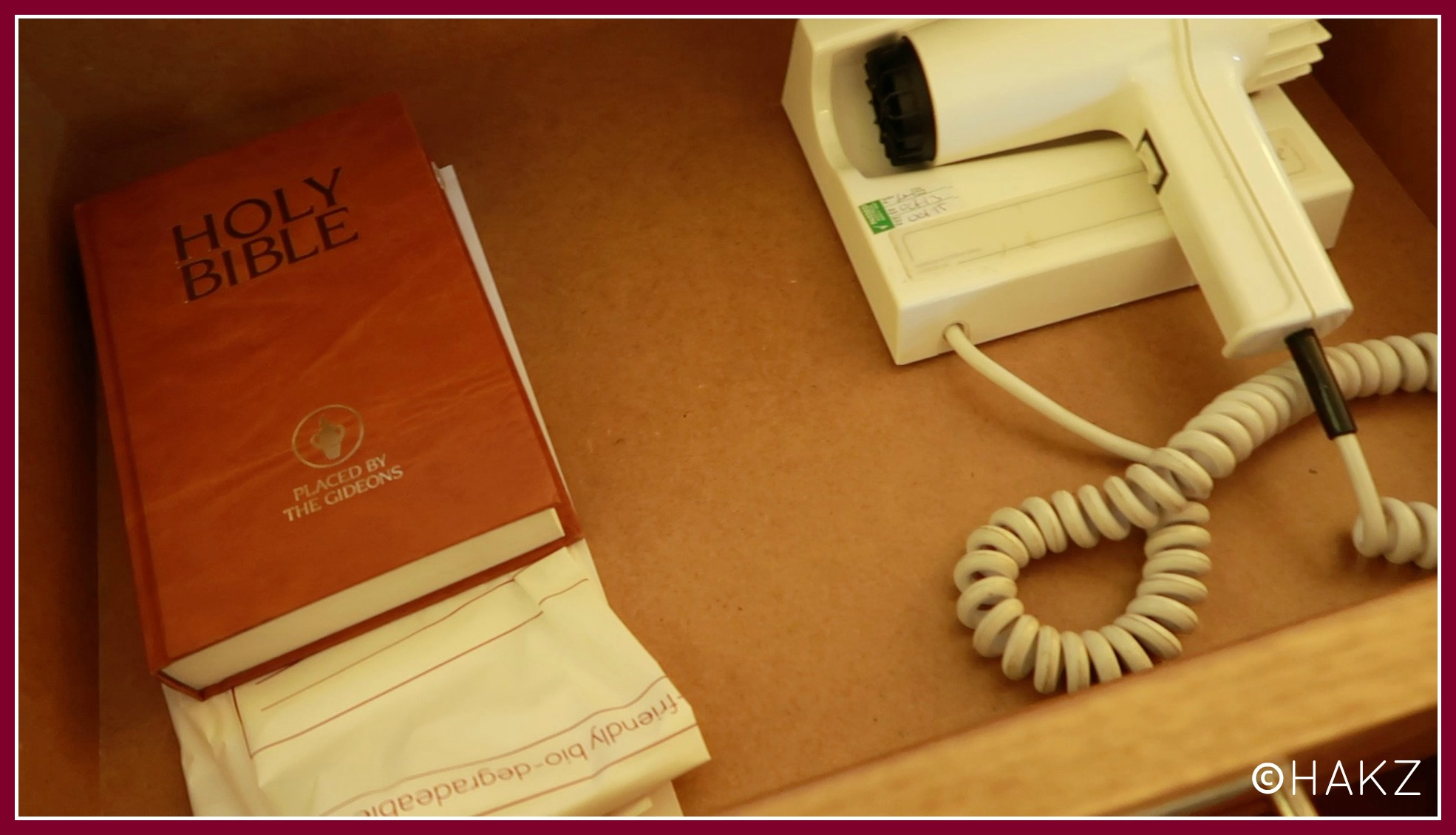 Manchester Airport hotel and parking: Clayton Hotel Manchester Airport bible and hairdryer